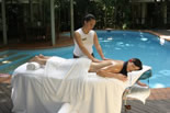 Massage by the private resort pool